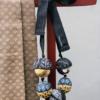 saturn-gold-necklace-twill-cravat-recycling-galerie-h-gift-crafts-valerie-hangel